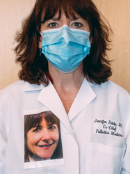 Jennifer Reidy wearing a PPE Mask and PPE Portrait